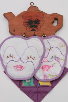 1930s vintage embroidered pansy flower faces potholders on painted pansies wood wall rack