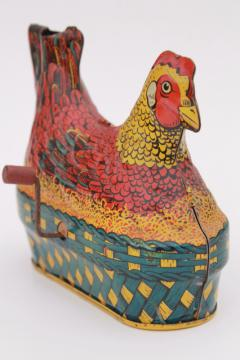 1930s vintage tin toy laying hen, metal litho print chicken on nest w/ egg