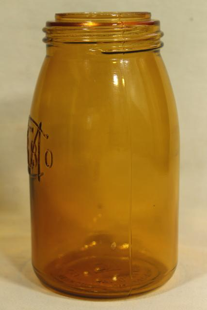 1970s vintage reproduction amber glass bottle, Buffalo Ball jar embossed mark canning jar