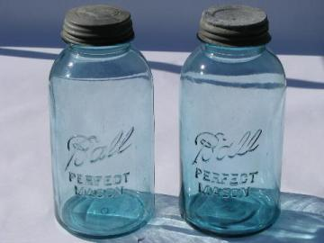 2 old Ball blue glass mason fruit jars/canisters w/ metal lids