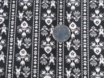 50s vintage folk art cotton fabric, hearts & tiny people print, white on black