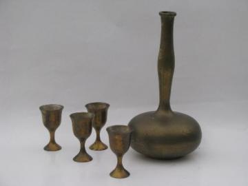 60s vintage solid brass genie bottle decanter and small goblet glasses