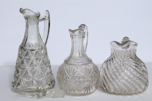 EAPG vintage pattern glass cruet bottles, heavy old glass pitchers, antique Fostoria jug