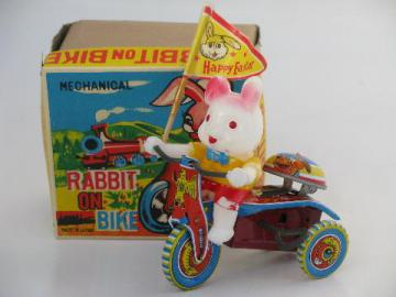 Easter Bunny on litho print bike, vintage Japan wind-up tin toy in box