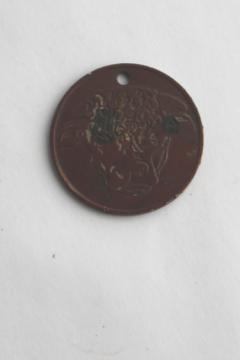 Hereford's Whiskey You Pay token, tarnished copper color coin w/ Hereford cow or bull