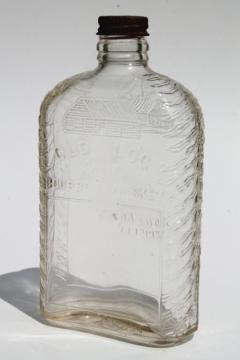 Old Log Cabin Bourbon Whiskey embossed glass bottle, vintage whisky pocket flask