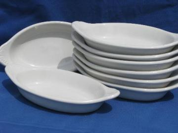 Set of eight ivory ironstone gratins, oval baking dishes