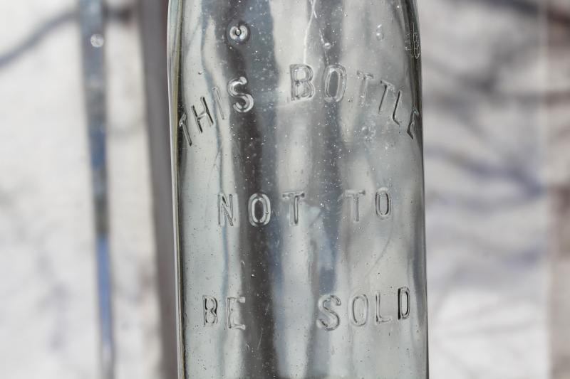 This Bottle Not To Be Sold vintage bail lid embossed glass bottle