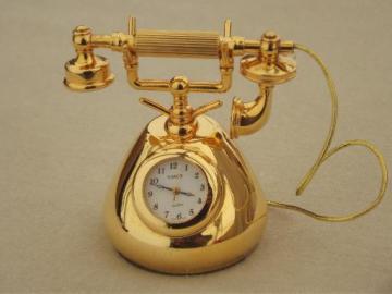 Timex miniature brass clock, old-fashioned phone figural clock, travel clock?