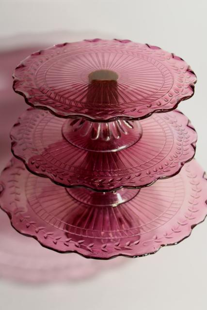 amethyst pink colored glass cake stands, scalloped edge laurel vines, tower of graduated sizes
