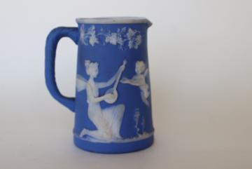 antique German jasperware china pitcher, blue and white raised relief classical scene