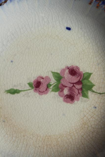 antique Limoges China, flow blue border w/ rose pink floral, American or French?