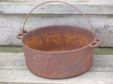 antique cast iron kettle, bean or stew pot for campfire and wood stove