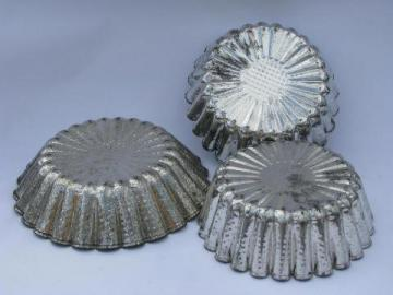 antique early 1900s tinned steel baking pans or food molds, flower shapes
