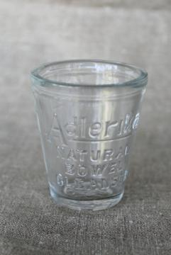 antique embossed measure glass medicine dose cup, Adlerika quack remedy bowel cure