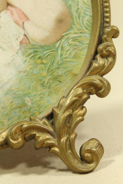 antique gilt picture frame w/ litho print young girl, small round ornate embossed brass frame