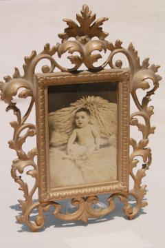 antique gold cast metal picture frame w/ vintage sepia tone baby photo