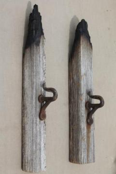 antique horse harness hooks on salvage barn wood, rustic architectural hardware