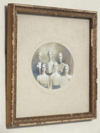 antique photos in  shabby old gold wood frames, pretty girls circa 1900