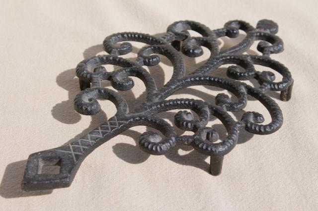 antique reproduction cast iron trivet collection, John Wright / Wilton Wrightsville trivets