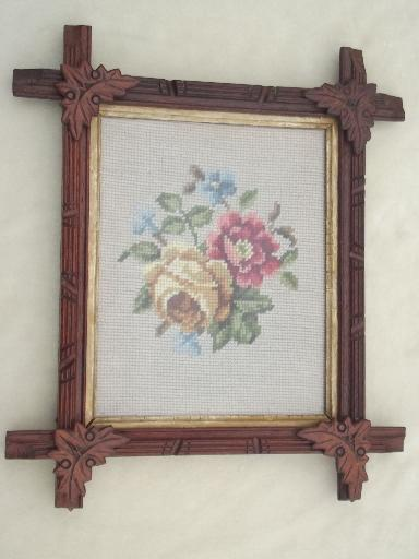 antique roses wool needlepoint in rustic Adirondack carved wood frame