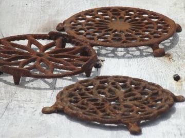 antique rusty iron trivets, primitive vintage round trivet collection