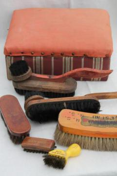 antique shoe shine brushes in old wood box footstool, vintage shoe polish kit