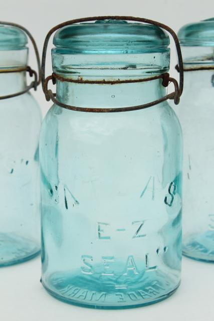 antique vintage Atlas glass canning jars, wire bail lid blue glass jars