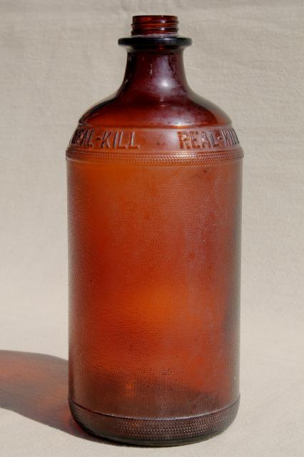antique vintage amber glass poison bottle, Real Kill embossed quart jar