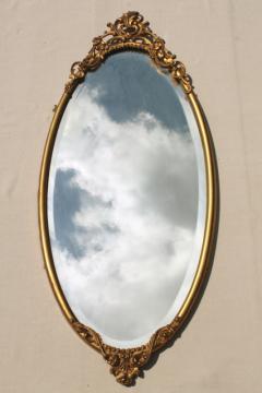 antique vintage beveled glass mirror w/ ornate old gold metal oval frame