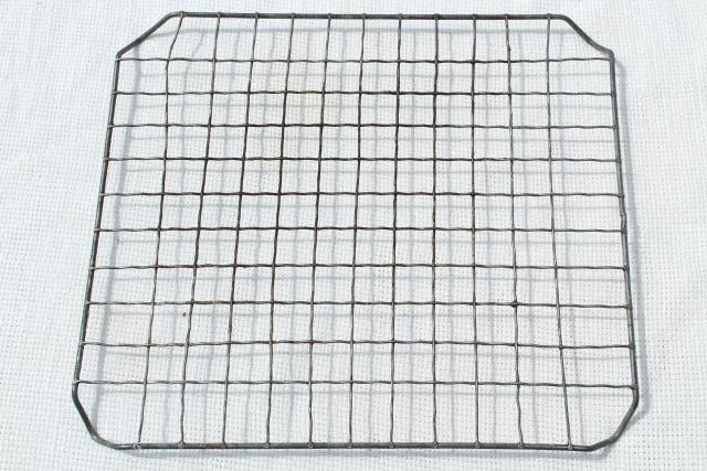 antique vintage kitchenware, old crimped wire cooling racks for pies or other baking