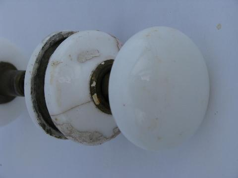 antique white ironstone porcelain and brass door knobs with matching china cover plates
