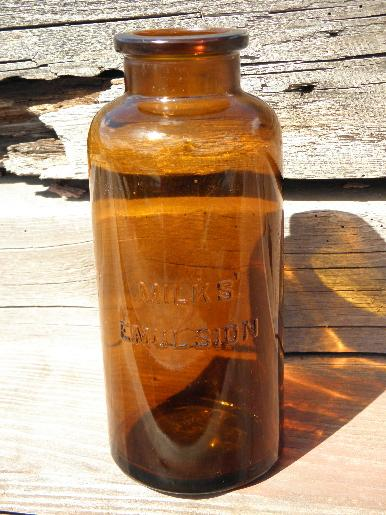 big old amber glass patent medicine bottle, Milks Emulsion display jar