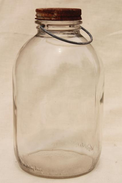big old bail handle glass pickle jar full of vintage wood clothespins