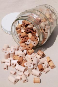 big old herring barrel glass jar full of tiny wooden spools, wood spool lot