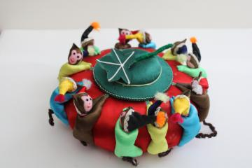 big old round Chinese satin pincushion w/ ring of worry dolls tiny monkeys in hats