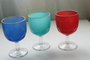 big vintage wine glasses or water goblets, retro colors red aqua blue
