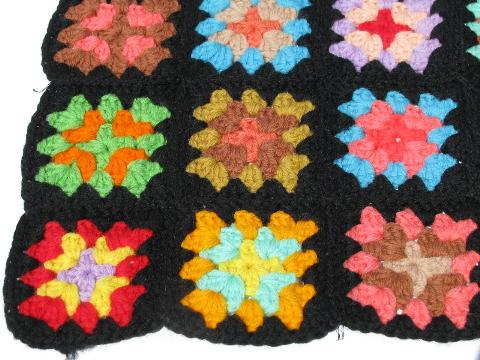black w/ brights granny squares, small child's doll size crocheted afghan, 1940s vintage
