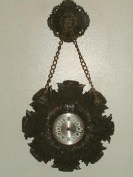burwood plastic wall clock w/ hanging medallion