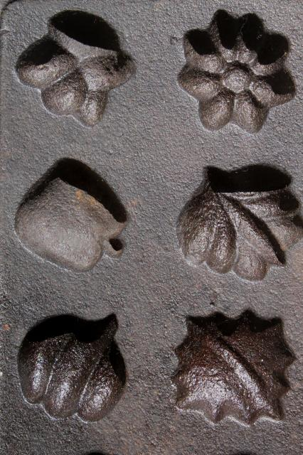 cast iron maple sugar mold for making tiny leaves, acorns, pumpkins, fall fruit