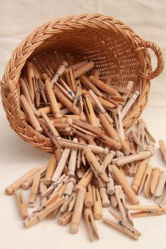child's size vintage wicker laundry basket full of old wood clothespins