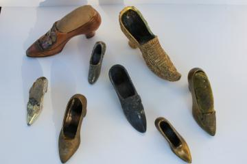 collection of antique vintage cast metal shoes, ladies shoe pincushions