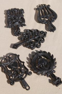 collection of mini trivets, cast iron trivet antique reproductions, vintage Virginia Metalcrafters