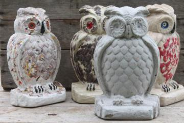 collection of old cement owls, owl doorstops or rustic garden ornaments