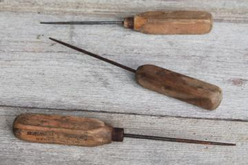 collection of vintage ice picks, primitive worn old wood handled tools