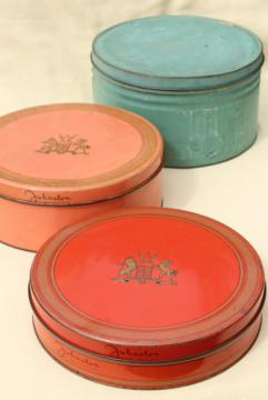 collection of vintage tins in faded colors, coral red, pink, blue