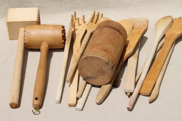collection of vintage wooden kitchen utensils, wood spoons, meat tenderizer mallets
