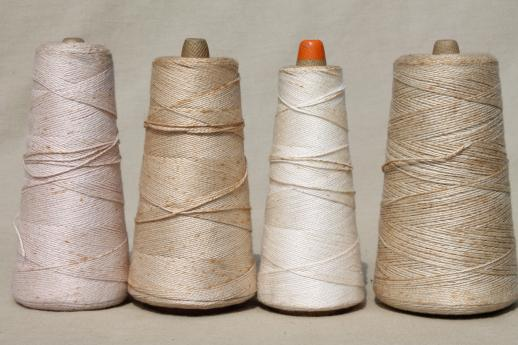 creamy white antique colors primitive grubby old spools of vintage cotton cord thread