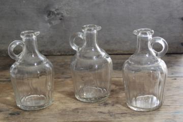 early 1900s vintage maple syrup bottles, jug shape pressed glass pitchers