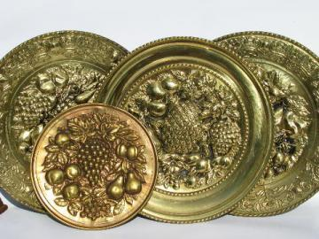 embossed solid brass chargers, large plates or trays, fruit pattern, vintage England